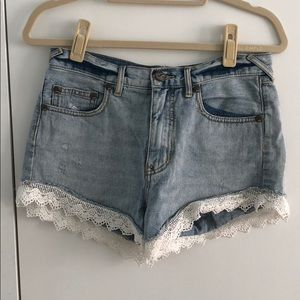 Free People jean shorts with crochet details